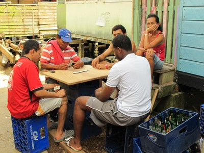 Neighbors of Saigon Bay enjoy a game of Dominoes.