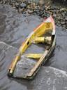 Dead boat lying on the shore