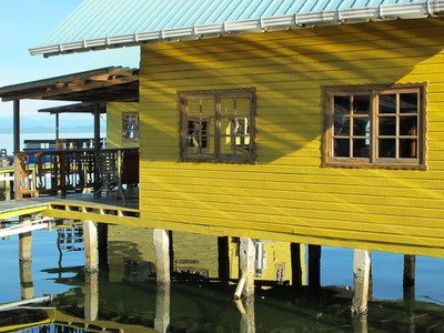 Morning sun lights up the yellow cabins at KoKo Resort