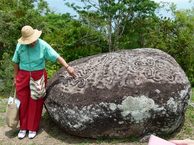Dr. Graciela showing the hole where some men 'impregnate' the rock as part of their ritual