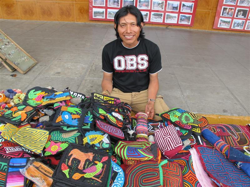 Kuna Indian selling handmade goods