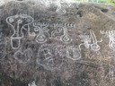 Some modern graffiti alongside the authentic drawings and carvings